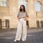 Modna stylizacja z bluzką i spodniami z wysokim stanem